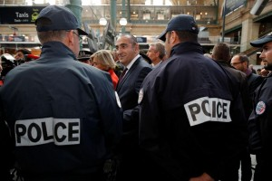 1197534-checknews-french-junior-interior-minister-laurent-nunez-talks-with-policemen-during-a-patrol-at-the-